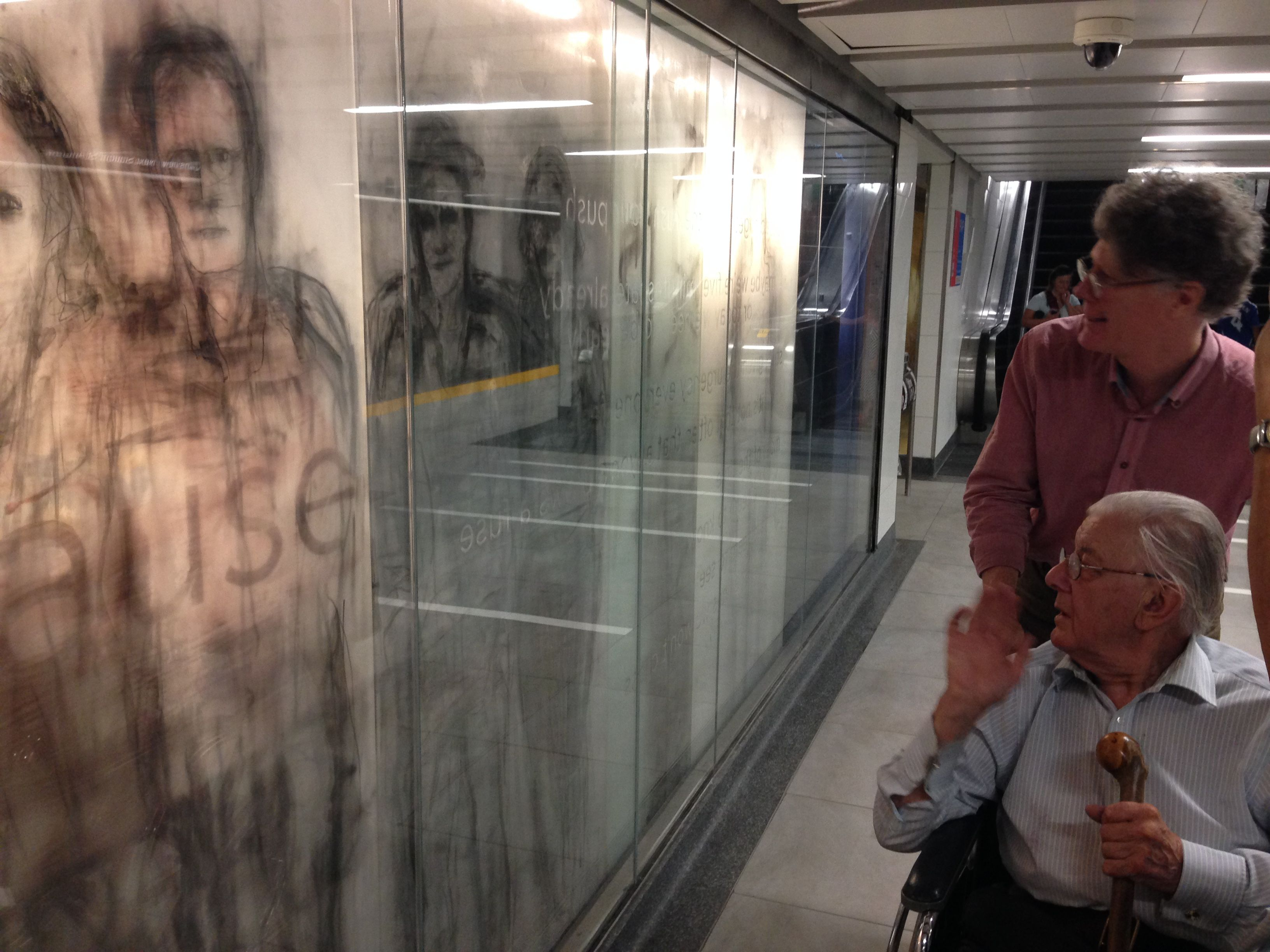 Stuart Reid and Patrick Reyntiens at Union Subway Station,Toronto, viewing his 104 foot long artwork
